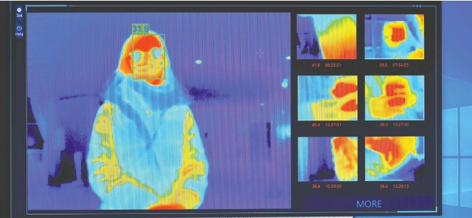 ?? Ben STANSALL / AFP VIA GETTY IMAGES ?? The results of a thermal imaging camera are shown as a person waits at the reception desk at the St Giles Hotel near Heathrow Airport in London recently. The hotel has offered to become one of England's designated quarantine hotels for travellers re-entering the country after visiting any country on England's red list.