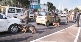 ?? PHOTO: PTI ?? Security personnel with sniffer dogs check vehicles outside the venue of Global Entrepreneurship Summit in Hyderabad on Monday