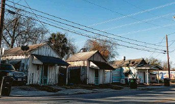 """?? Billy Calzada / Staff photographer ?? A row of homes in San Antonio includes a """"shotgun house,"""" right, thought to have been built in the 1870s. City officials believe such houses can be used to help in the recovery from the pandemic."""
