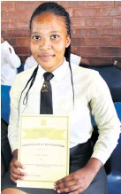 ??  ?? Mawande Gumede was presented with a certificate as one of the best in Grade 12