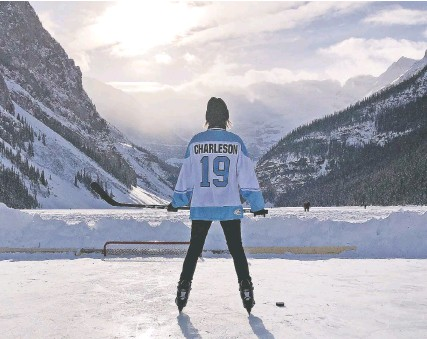 ??  ?? Mary Charleson secures a treasured photo keepsake: posing on Lake Louise in her Stanley Cupcakes team jersey.