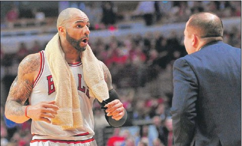?? | SUN-TIMES MEDIA ?? Bulls forward Carlos Boozer is upset with coach Tom Thibodeau about his playing time in the fourth quarter.
