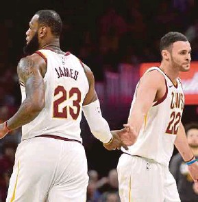 ??  ?? Cleveland Cavaliers' LeBron James (left) and Larry Nance Jr celebrate during their game against the Detroit Pistons on Monday. REUTERS PIC