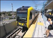 ?? Luis Sinco Los Angeles Times ?? SENATE BILL 50 would require cities to allow fourto-five story apartment complexes near transit lines such as the Expo Line station at Bundy Drive, above.