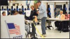 ?? Brian A. Pounds / Hearst Connecticu­t Media file photo ?? Voters checking in to pick up their ballots at Wooster Middle School in Stratford in 2017.
