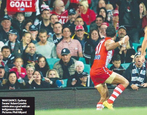 ??  ?? WAR DANCE: Sydney Swans' Adam Goodes celebrates a goal with an indigenous dance. Pictures: Phil Hillyard
