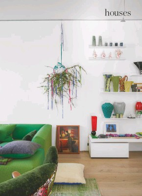 ??  ?? LIVING ROOM Ombre-dipped curtains add bright colour while also diffusing the light, creating a beautiful luminous effect. Curtains in hand-dyed Savoie linen in Cobalt and Lemongrass, Designers Guild. Mags soft low armrest sofa by Hay; upholstered in Capisoli wool in Grass by Designers Guild. Christmas 'wreath', Juliet Glaves for Designers Guild. Custom shelves, MDF Italia; showcasing pieces by Amy Hughes, Kate Mcbride and Royal College of Art graduates