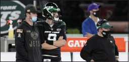 ??  ?? In this Monday, Nov. 9, 2020, file photo, New York Jets quarterbac­k Sam Darnold, left, looks on from the sidelines during a game against the Patriots.