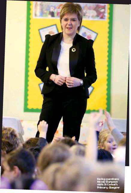 ??  ?? Making his point: Prince Charles Facing questions: Nicola Sturgeon visits St Conval's Primary, Glasgow