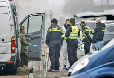 ??  ?? A bomb squad was sent to determine whether any explosive material remained following an explosion near a COVID-19 test center in Bovenkarsp­el, Netherland­s, on March 3, 2021.