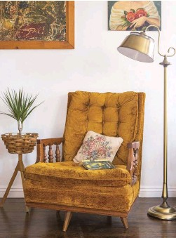 """??  ?? right: THE """"SUPER COMFORTABLE 1970S CHAIR,"""" Emily says, is from the Salvation Army."""