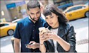 ?? Drew Angerer Getty Images ?? SAMEER UDDIN and Michelle Macias play the game outside a Nintendo store in New York. Police advise players to be aware of their surroundings.