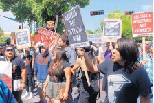 """?? MORGAN LEE/ASSOCIATED PRESS ?? Demonstrators in Santa Fe protest against the annual re-enactment of the """"entrada"""" of Spanish conquistador Don Diego de Vargas in 1692, 12 years after the Pueblo Revolt drove out Spanish settlers. Tributes to early Spanish conquerors are facing..."""