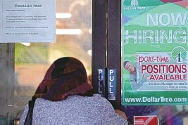 ?? NAM Y. HUH/ASSOCIATED PRESS ?? A shopper enters a retail store as a hiring sign shows in Buffalo Grove, Ill., June 24.