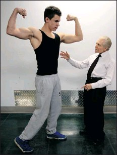 ?? JOHN MAHONEY THE GAZETTE ?? Jimmy Caruso, not a tall man, is dwarfed by his 17-year-old protegé, Max Garneau-Pillet, who is more than 6 feet tall.