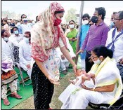 ?? PIC/MPOST ?? Mamata Banerjee speaks to families of those who died in the Sitalkuchi clash, at Mathabhanga in Cooch Behar district, on Wednesday