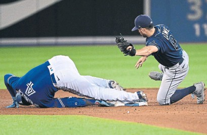 ?? JON BLACKER THE CANADIAN PRESS ?? George Springer slides safely into second base with a fourth-inning double, the Blue Jays' only extra-base hit Tuesday.