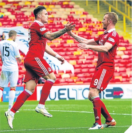 """??  ?? Miles Storey celebrates with Adam Rooney after making it 2-0 to Aberdeen. GRAEME SHINNIE is one of those consistent """"seven out of 10"""" guys managers build teams around. His presence has been vital for Aberdeen over the last year – and was again against..."""