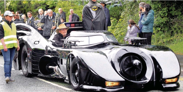 ??  ?? Batman and his amazing car in the Marple Carnival parade