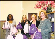 ?? Community Health & Wellness Center / Contributed photo ?? Holding beauty bags for clients of the Susan B. Anthony Project are, from left, Wendy Green, SBA bilingual advocate; Anne Malisk, SBA advocate; Denise Torson, SBA development associate, and Joanne Borduas, CEO of the Community Health and Wellness Center.