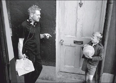"""?? Photographs by Rob Youngson Focus Features ?? WRITER-DIRECTOR Kenneth Branagh, left, talks with young actor Jude Hill on the set of his autobiographical film """"Belfast."""""""