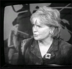 ?? —CBS-TV ?? Still covered with dust, Carol Marin talks on the air after her experience of being near the World Trade Center towers when they collapsed.