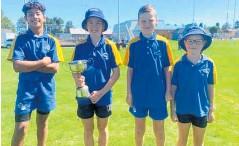 ?? Photo/ Supplied ?? Matapu School's winning relay team, holding the Chapman Challenge Relay Cup. From left: Foma'I Vaitupu, 12, Maddison Sturgeon, 11, Blake Luscombe, 10, and Savannah Burke, 9.