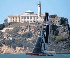 ?? REUTERS ?? Oracle Team USA sail past Alcatraz Island during Race 16.
