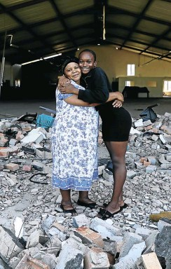 ?? Picture: Sandile Ndlovu ?? Thembelihle Ndabandaba at the Pentecostal Holiness Church in Ndlangubo with her granddaughter S'bani Phiri, who cheated death there two years ago.