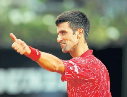 ??  ?? EYEING 18TH SLAM: Novak Djokovic reacts during the Italian Open final against Diego Schwartzman.