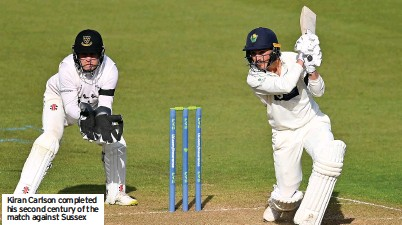 ??  ?? Kiran Carlson completed his second century of the match against Sussex