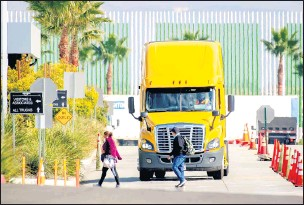 ?? WATCHARA PHOMICINDA STAFF PHOTOGRAPHER ?? A truck leaves an Amazon Fulfillment in Eastvale in November. The state wants more zeroemission trucks on its roads in an attempt to cut down on air pollution.