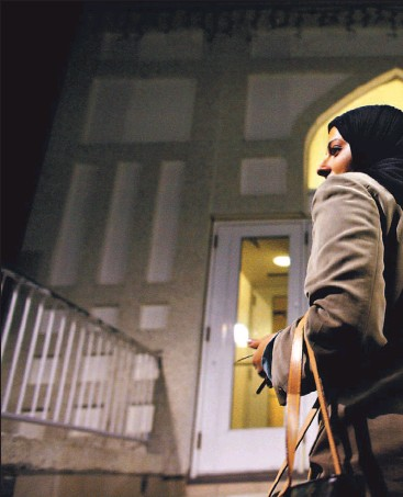 ??  ?? Tanya Khan mounts the steps of her Vaughan mosque for special Ramadan evening prayers, which are spiced