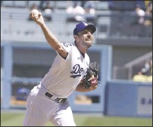 ?? KEVIN REECE Special to the Valley Press ?? The Dodgers' Max Scherzer throws against the Padres on Sunday. He pitched his 3,000th career strikeout against Padres first baseman Eric Hosmer in the fifth inning and was perfect through seven innings in the Dodgers' 8-0 victory.