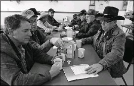 ??  ?? Paul Webb, left, and Ray Scott, second from left, join Stockburger, right, for a coffee and some political talk at Granny's Country Kitchen in Sundre on Friday.