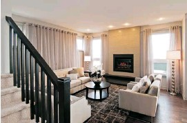 ??  ?? At Cardel Homes, a fireplace has become a de rigueur focal point as the company replaces the traditional living room with an open-concept family room or great room/kitchen. Shown is the great room of its Inverness II model in Blackstone.