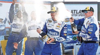 ?? BRIAN LAWDERMILK, GETTY IMAGES ?? Jimmie Johnson and his team celebrate his 76th career win, tying him with Dale Earnhardt Sr.