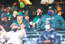 ?? Santiago Mejia / The Chronicle ?? Fans watch the Oakland Athletics and Minnesota Twins at RingCentral Coliseum in Oakland on Tuesday.