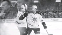 ?? JEFF ROBERSON/ASSOCIATED PRESS ?? Karson Kuhlman, at left with McAvoy, scored one of the Bruins' four third-period goals in a 5-1 victory in Game 6 on Sunday.