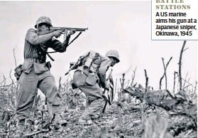 ??  ?? BATTLE STATIONS A US marine aims his gun at a Japanese sniper, Okinawa, 1945