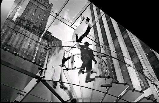 ?? 2016 File Photo/Getty Images ?? Masinter and his partners at Open Realty Advisors found the locations for all of Apple's 300-plus stores in North America, including the hard-to-miss glass cube over the underground store on Fifth Avenue in New York City.