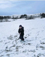 ??  ?? Henry Hartley, 3, makes plentuy of tracks in the white stuff