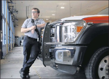 ?? MATT GENTRY/THE ROANOKE TIMES ?? Cameron Buck, 21, a Virginia Tech senior fromHenrico County and a volunteer with the Blacksburg Rescue Squad, spent 31 days over the summerworking with COVID-19 patients at a South Texas hospital. He hopes to pursue a medical career.