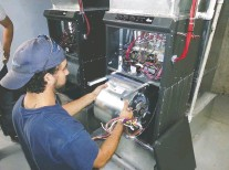 ??  ?? A Duct Mas­ters tech­ni­cian re­moves the blower and mo­tor from a fur­nace since, to max­i­mize the air qual­ity in a home, the com­pany of­fers the clean­ing of this equip­ment in ad­di­tion to clean­ing the ducts.