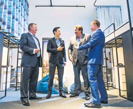 ?? Pictures: Simon Santi ?? Campus Perth's Brian McHenry, Gaw Capital's Kenneth Gaw with GCP Hospitality's Christophe Vielle and Tony Chisolm in a mocked-up student share room at 80 Stirling Street.