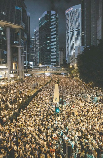 ?? JEROME FAVRE/EPA-EFE/SHUTTERSTOCK ?? Police said turnout was about 240,000, one of the largest in recent memory. But organizers estimated the crowd at more than 1 million, possibly making the demonstration the largest in Hong Kong history.