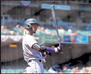 ?? DANIEL SHIREY / Getty Images ?? The Rockies' Raimel Tapia prepares before his at-bat in Sunday's game against the Giants at Oracle Park in San Francisco.