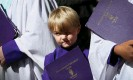 ??  ?? A choirboy looks on as dignitaries leave the cathedral. Photograph: Lisa Maree Williams/Getty Images
