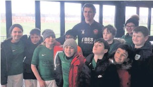 ??  ?? The St Anne's Church Primary School with Joey Barton in January