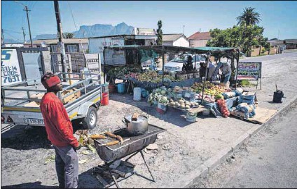 ?? Photo: David Harrison ?? Pavement specials: Research shows that small businesses, such as these in Langa, are often overlooked in favour of corporate developments and supermarket chains, which have no social role.